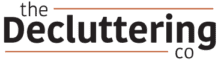 The Decluttering Co logo with an orange stripe above and below
