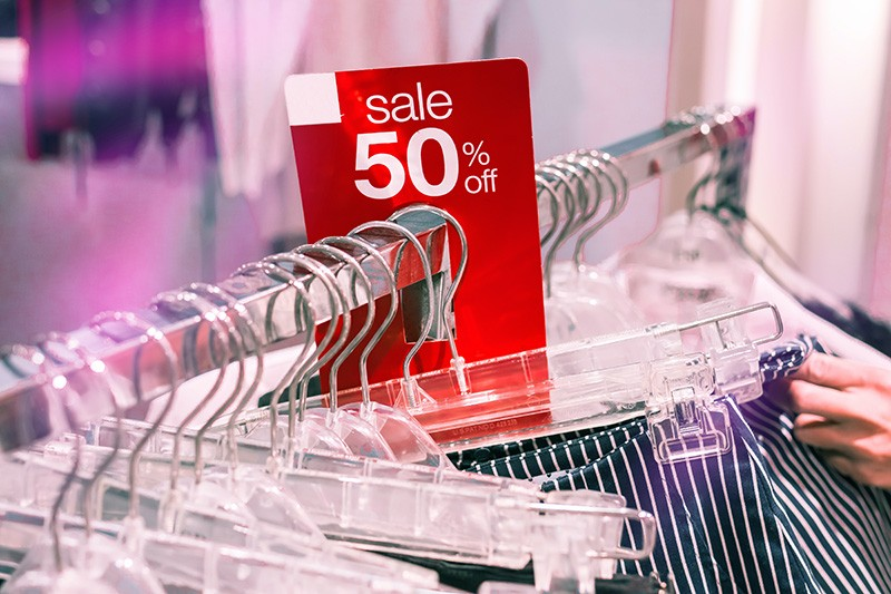 Professional Organiser on a budget, sale rack of clothes