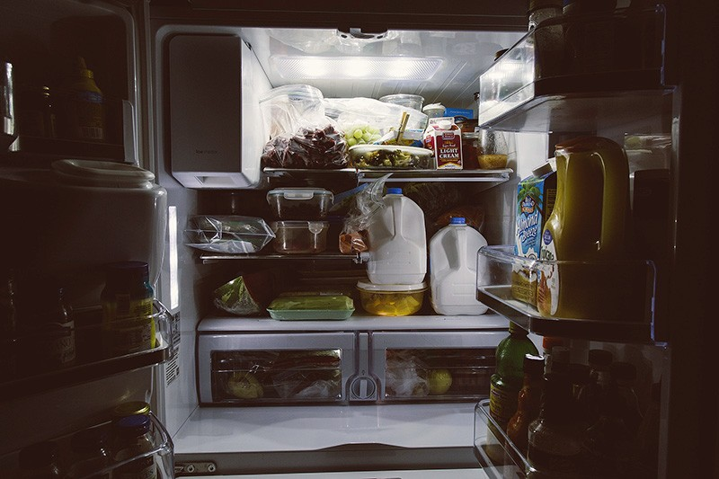 declutter your fridge, this one is crowded with milk and grapes
